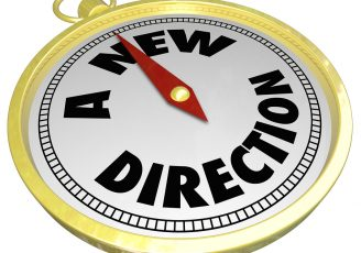 A New Direction words on a gold compass choosing a changed path