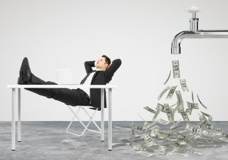 Businessman Resting On A Chair And Faucet From Which The Money F
