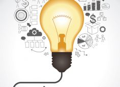 Concept of productive business ideas. Lightbulb with drawing gra