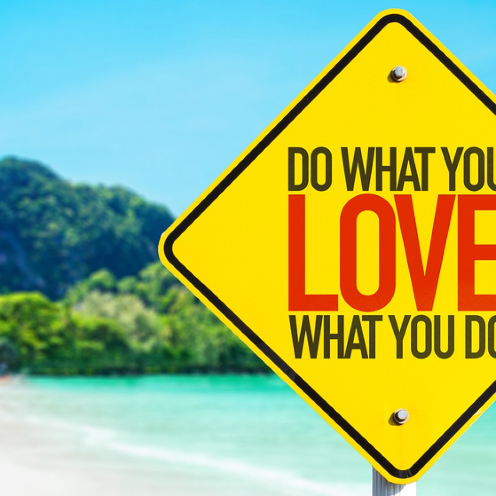 Do What You Love What You Do sign with beach background